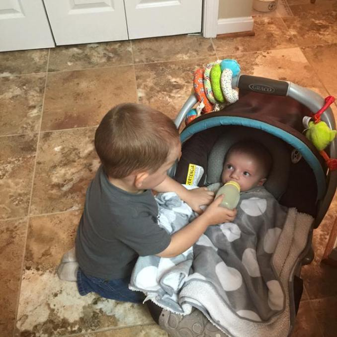 Big brother feeding little