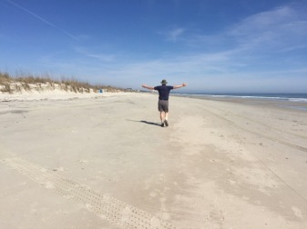 Bill demonstrating how wide the beach is!