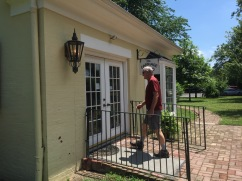 Bill entering the Carriage House, now serving as the Gift Store.