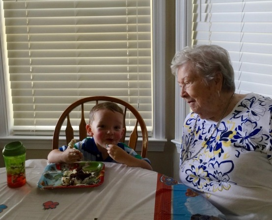 Mom at 93 and rosy cheeked Colin (from playing outside) is chowing down his 3rd birthday cake!