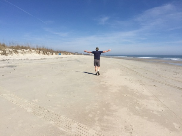 Bill is showing how flat and wide this beach is! Great for long walks.