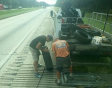 Bill and the truck driver looking at how good our damaged tire was.