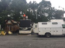 Both men up on the top of our motorhome - checking things out and removing the old A/C