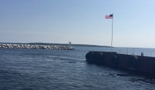 We are now departing on a much smaller ferry, hated to Rock Island State Park - in the distance! I love our American Flag - which shows it was a bit windy....
