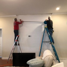 Bill's first big project was to hang shiplap. He did it all by himself until the very end. He needed a pro to cut a few finger size slivers.