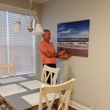 Bill hanging a picture we took in our kitchen area.