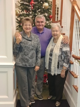 Mom with Marsha and her husband at her apartment complex. Nicely decorated for Christmas!