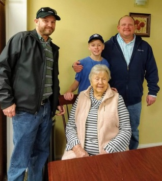 Mom surrounded by her local two adult grandsons and great grandson during the holidays.