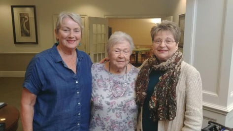 Mom surrounded by my two sisters in November 2019,