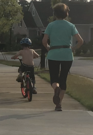 I loved running behind him as he was JUST starting to ride without training wheels.